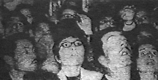 Close-up view of people watching the apparitions